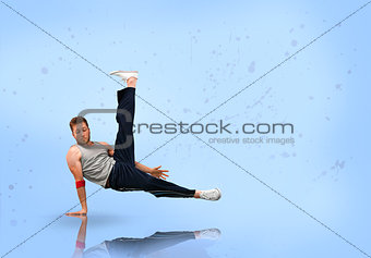 Break dancer balancing on one hand