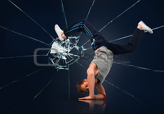 Break dancer balancing on forearms