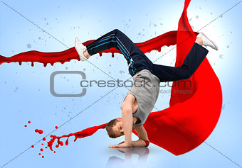 Break dancer balancing on his forearms with reflection below