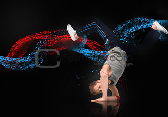 Skilled male dancer balancing on his forearms