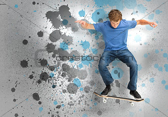 Male skateboarder doing an ollie trick