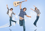Three of the same teenage boy jumping for joy one holding a guitar