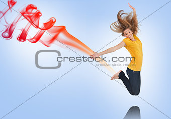 Pretty young woman jumping for joy with smoke trail