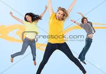 Three happy friends jumping for joy