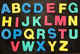 Alphabet magnets stuck on blackboard