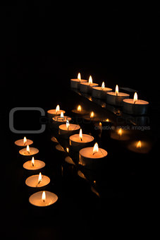 Candles at the alter lighting up the darkness