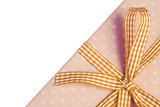 Yellow gift wrapped present with gingham ribbon