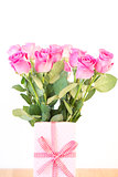 Bouquet of pink roses with pink gift