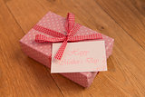 Pink wrapped present with mothers day card