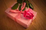 Pink wrapped present with pink rose and vignette frame