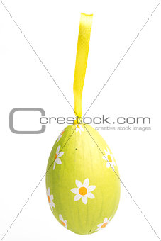 Green wrapped Easter egg with daisy pattern