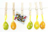 Easter eggs hanging from a line with queen of hearts