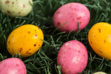 Many little easter eggs in the grass