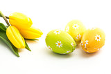 Three easter eggs with yellow tulips