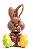 Cute chocolate bunny with two easter eggs