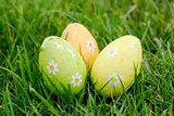 Three easter eggs in the grass