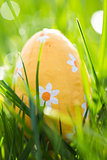 Easter egg wrapped in foil nestled in the grass