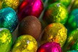 Colourful easter eggs with one unwrapped