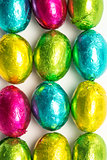 Colourful foil wrapped easter eggs overhead shot