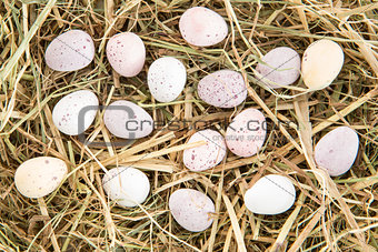 Little candy easter eggs on straw