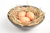 Three eggs in a black bowl