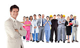 Businessman standing in front of different types of workers