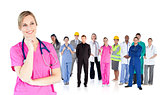 Nurse standing in front of different types of workers