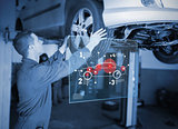Mechanic checking wheel of a car while looking interface