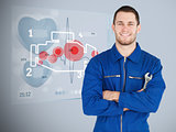 Portrait of a young mechanic with futuristic interface next to him