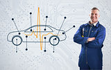 Mechanic standing proudly in front of a diagram car on background