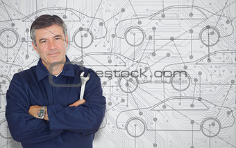 Mature mechanic standing in front of a cars diagram background