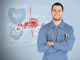 Portrait of a young mechanic next to futuristic interface with diagram