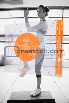 Woman doing exercise with futuristic interface in black and white