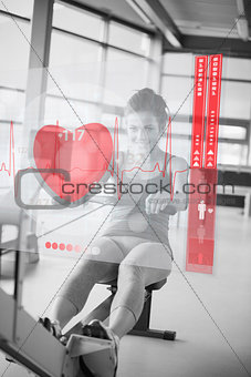 Young girl doing rowing machine with futuristic interface in black and white