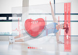 Woman doing yoga while looking at futuristic interface showing her heartbeat