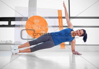 Attractive woman doing yoga with futuristic interface next to her