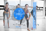 Women doing exercises with trainer while looking futuristic interface