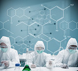 Chemists working in protective suit with futuristic interface showing formula