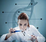 Blonde scientist pouring liquid into erlenmeyer in front of futuristic interface