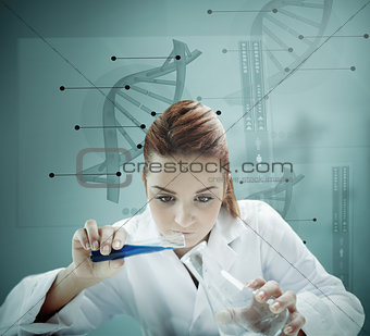 Blonde scientist working with futuristic interface and pouring liquid into erlenmeyer