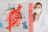Chemist working in protective suit with futuristic interface in front of her