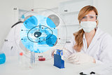 Scientist with protective mask using cell diagram interface