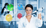 Serious chemist working with colourful dna helix diagram inteface