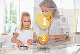 Grandmother and granddaughter baking with interface