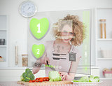 Smiling woman making salad using hologram interface