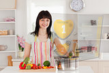 Smiling woman making dinner using hologram interface