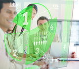 Business people using green pie chart interface