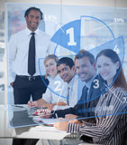 Smiling business people using blue pie chart interface