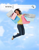 Happy girl jumping with her shopping bags under address bar
