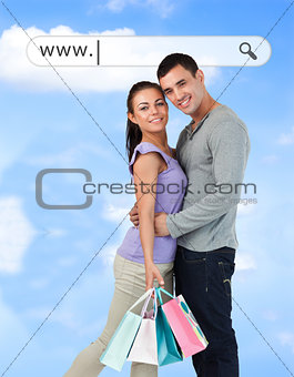 Happy couple with their shopping bags under address bar